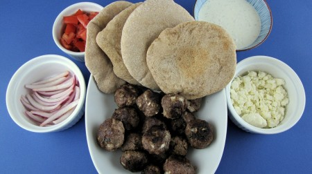 Meatballs, pita, feta, tzatziki, marinated onions, feta and tomatoes